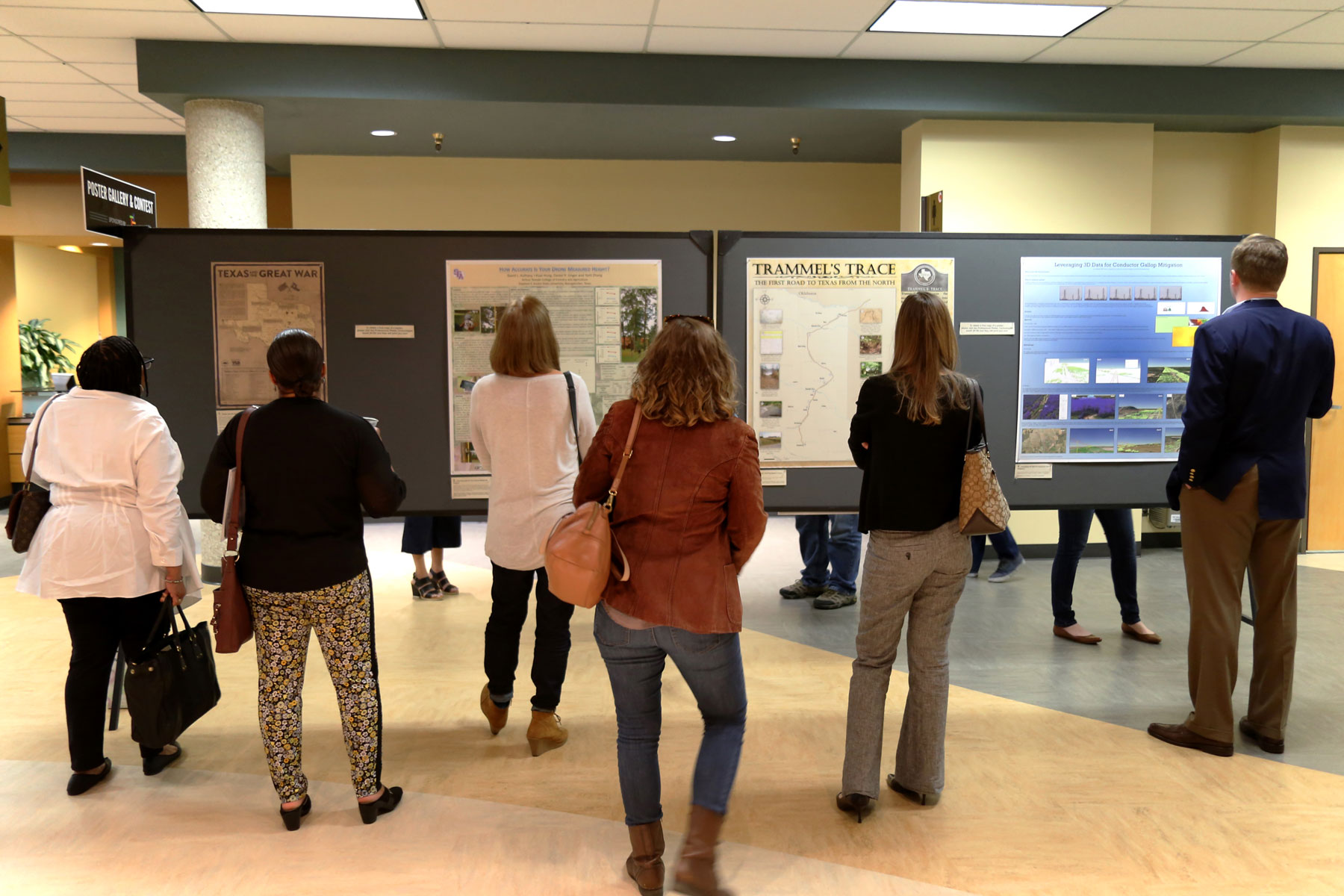 Forum Attendees looking at the Poster Gallery